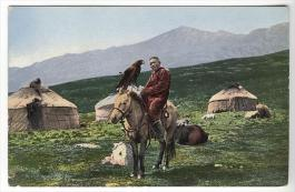 Kazakh on horse with Golden Eagle with yurts on background 1911-1914
