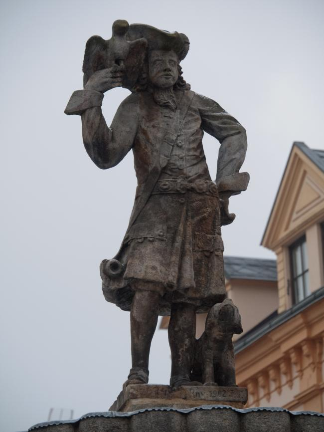 Stone statue of a falconer with his dog and a falcon in Falknov nad Oh?� 5
