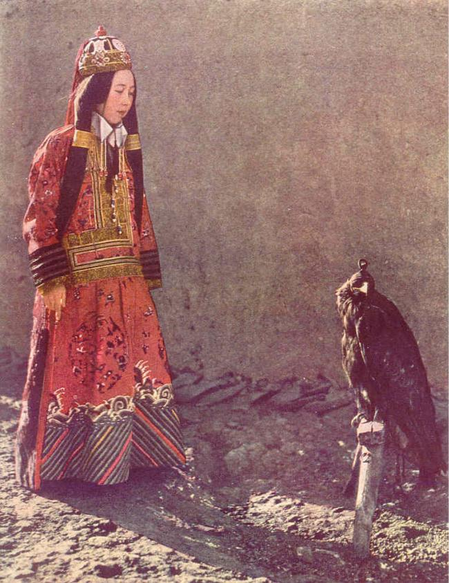 Princess Nirgidma with her hooded hunting eagle at Urumchi.
