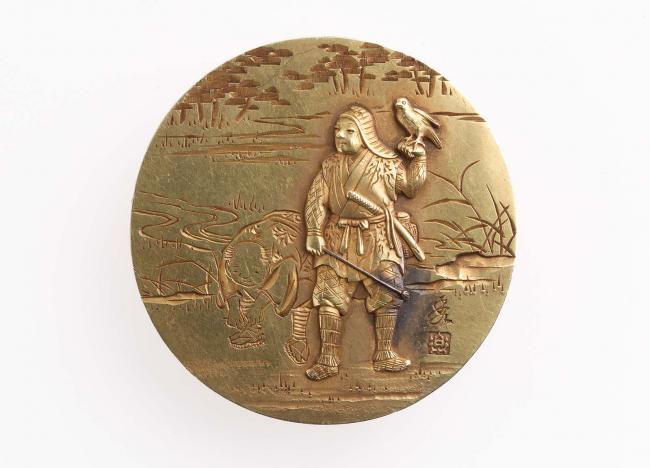 Kagami netsuke with design of a falconer and assistant