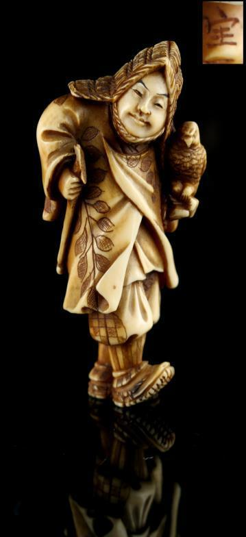 The Gill Collection of Japanese Netsukes - a carved ivory netsuke modelled as a falconer, signed Hoi
