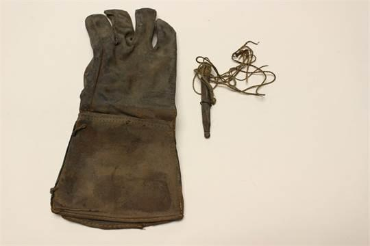 Lot 4083. A vintage Falconry glove and lure from Etwall, Derbyshire, UK